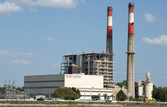 Increasing federal regulation of clean air standards for coal-fired electric generation plants has caused electric utilities in South Carolina to close some plants and sideline others. The Grainger plant, pictured, in Horry County is kept on standby for peak demand periods, but otherwise is idle. Its future is under review by owner Santee Cooper. (Photo/Jim Huff) 