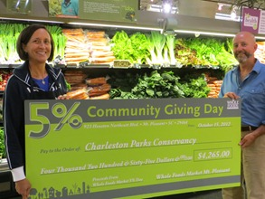 Whole Foods representative Pam Fischette presents a check to Jim Martin, executive director of the conservancy. (Photo/Provided)