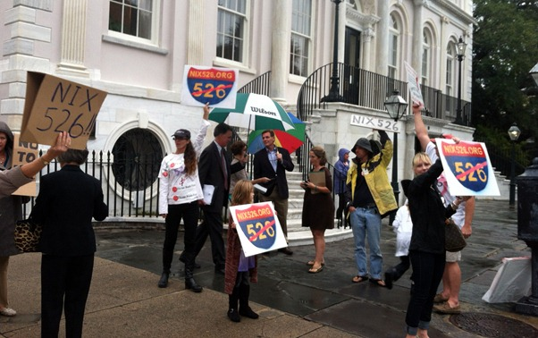 Protestors stood outside Charleston City Hall holding signs calling for the  demise of the Interstate 526 project. (Photo/Lauren Ratcliffe)