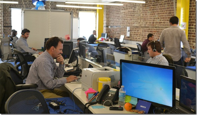 Exposed brick walls accent the PeopleMatter office on King Street. (Photo/Lauren Ratcliffe)