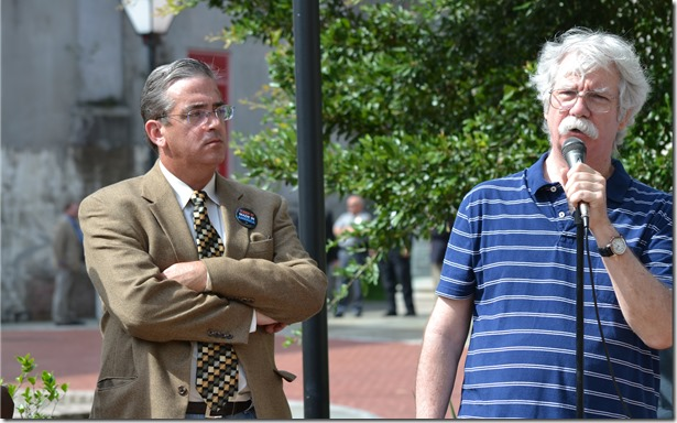 George Hopkins, Charleston coordinator for the S.C. Progressive Network, speaks out in downtown Charleston against the Charleston Metro Chamber's previously planned union seminar on social media as Rob Groce, AFL-CIO operations campaign manager, waits to speak. (Photo/Liz Segrist)