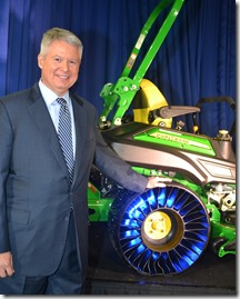 Michelin North America Chairman and President Pete Selleck before a John Deere mower equipped with the Tweel airless radial tire. (Photo by Bill Poovey)
