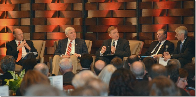 Clemson University President Jim Clements (from left), MUSC President Dr. David Cole, College of Charleston President Glenn McConnell and Charleston Southern University President Jairy Hunter speak with panel moderator Chris Fraser, president of Avison Young real estate firm, during an event held by the Charleston Metro Chamber of Commerce. (Photo/Ashley Heffernan)