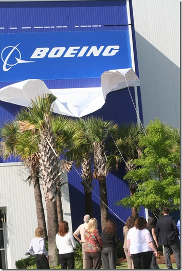 Boeing Co.'s logo and signage is unveiled at the former Vought Aircraft Industries plant in North Charleston. (Photo/Molly Parker)